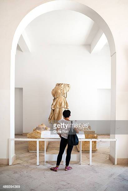 CONTENT] Girl looking at a statue at the Bardo Museum in Tu