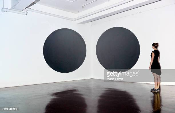Girl looking at art installation in a gallery space