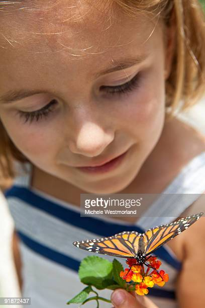 Girl Looking at Butterfly
