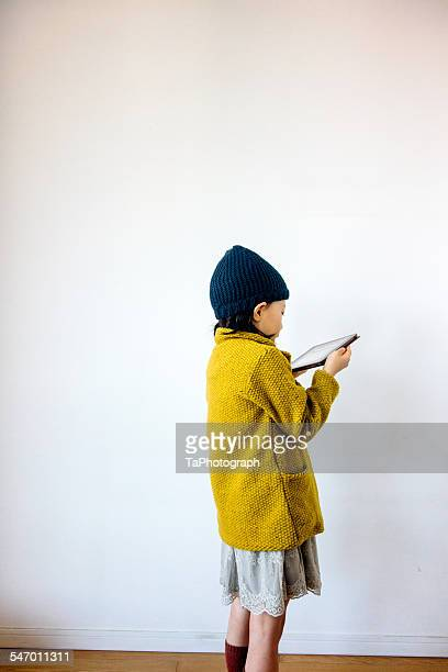 Girl looking at digital tablet