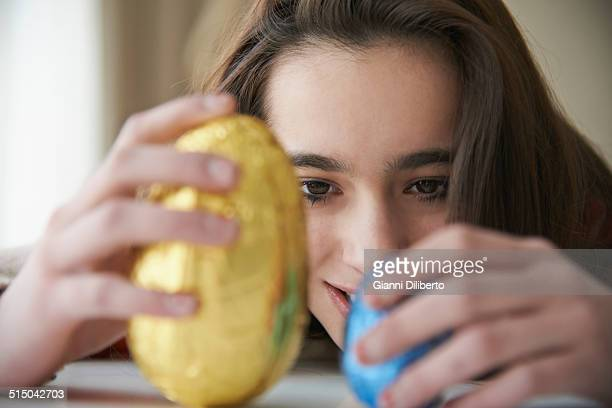 girl looking at easter eggs in house - easter egg stock pictures, royalty-free photos & images