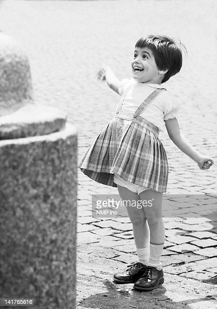 Girl looking at fountain