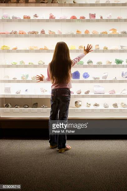 girl looking at gems in natural history museum - gemology stock pictures, royalty-free photos & images