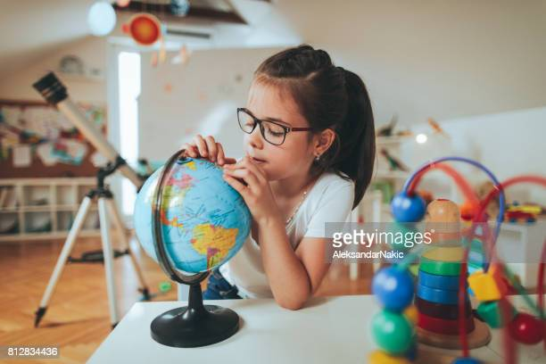 Girl looking at globe