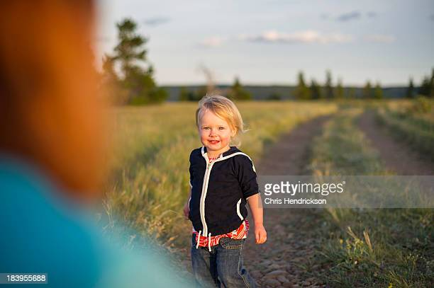 Girl (2 years old) looking at mother