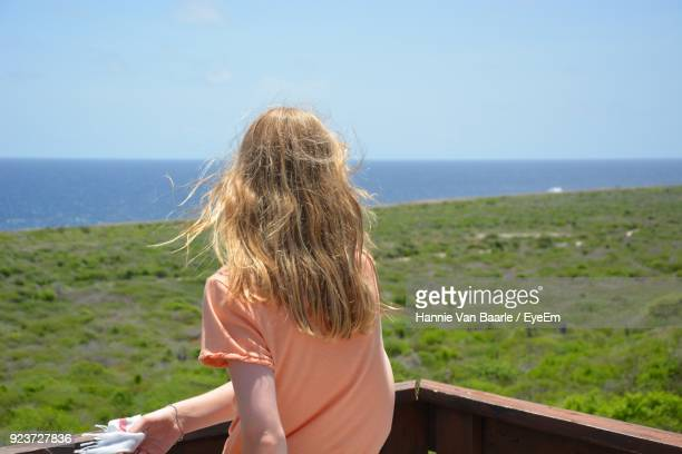 Girl Looking At Sea Against Clear Sky
