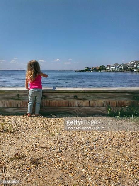 girl looking at sea - mcconnell stock pictures, royalty-free photos & images