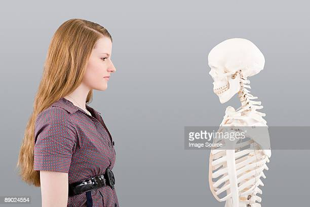 Girl looking at skeleton