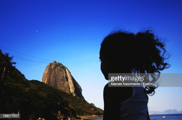 Girl Looking At Sugarloaf Mountain Against Clear Blue Sky