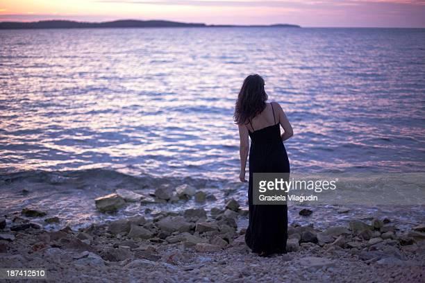 Girl looking at sunset in Croatian beach
