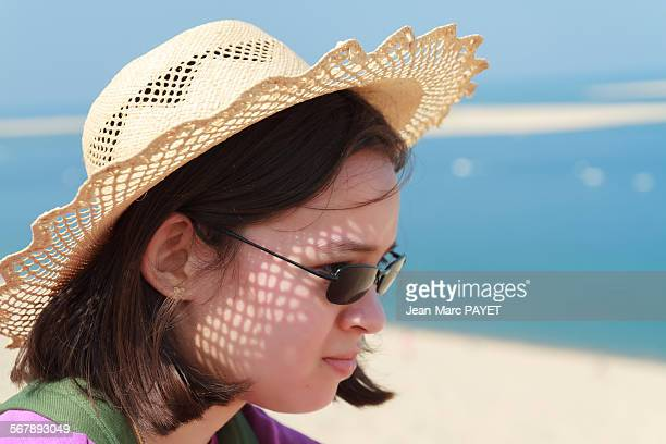 girl looking at the horizon - jean marc payet stock pictures, royalty-free photos & images