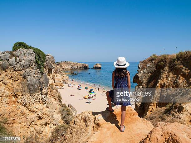 girl looking at the sea from clift - albufeira stock pictures, royalty-free photos & images