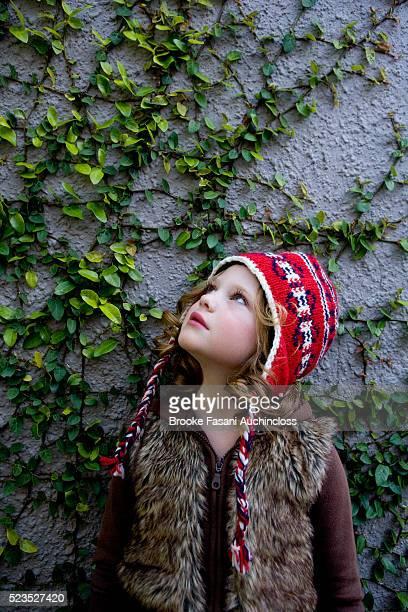 Girl (7-9) looking at vine