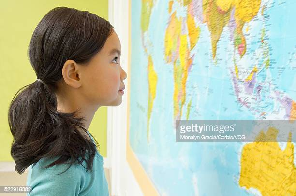 girl looking at world map - bottomless girl stock pictures, royalty-free photos & images