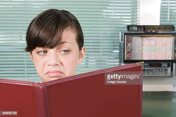 Girl looking disgusted with menu