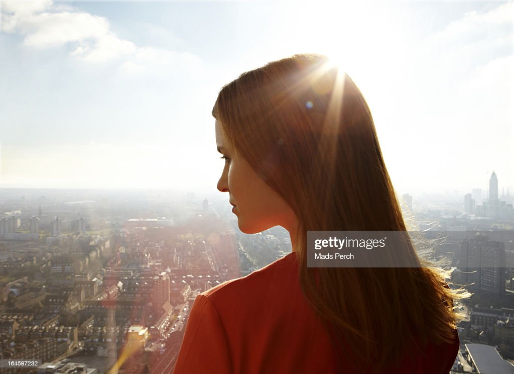 Girl looking down on the city : Stock Photo