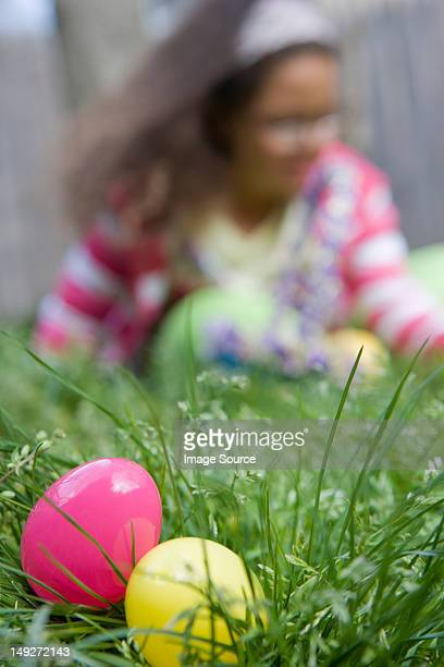 Girl looking for easter eggs in grass