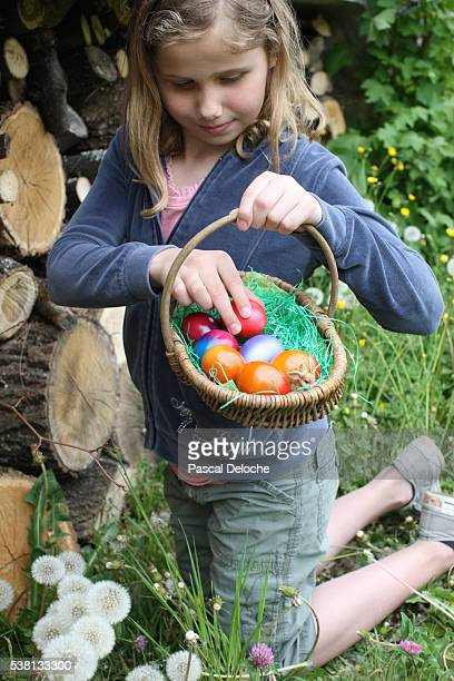 girl looking for easter eggs. - easter egg hunt stock pictures, royalty-free photos & images