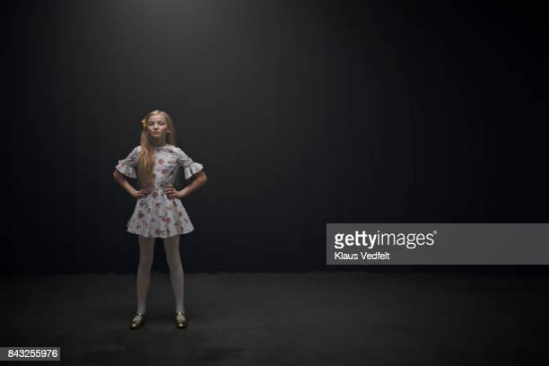 Girl looking in camera with hands on the hips