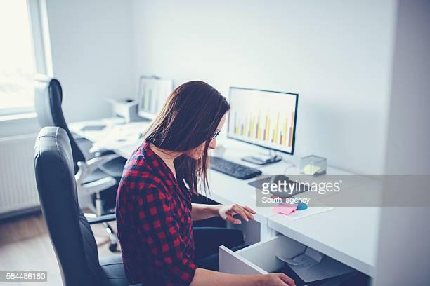 Girl looking in desk drawer