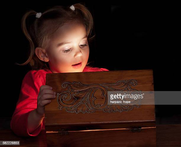 Girl looking into an illuminated box