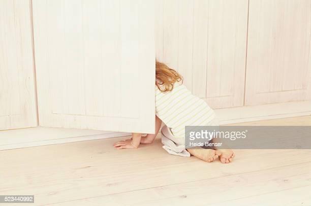 Girl Looking into Cupboard