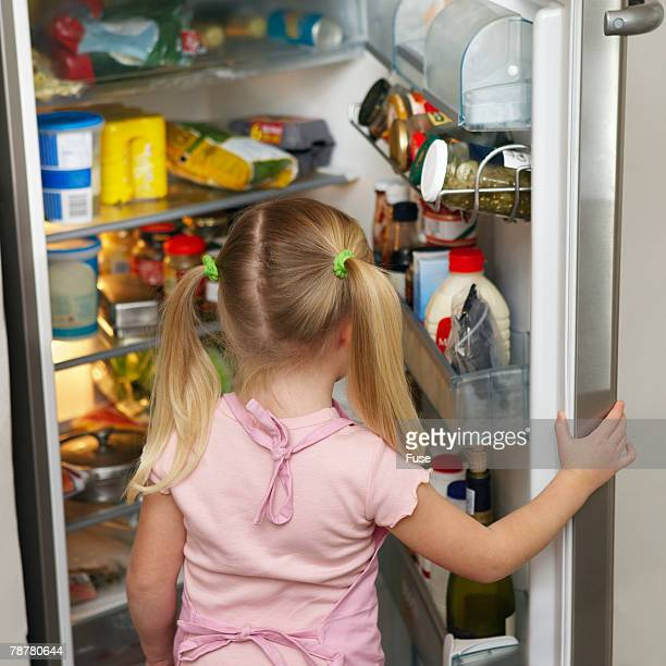 Girl Looking into Refrigerator