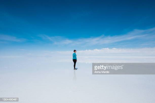 girl looking into the distance at salar de uyuni - bolivia stock pictures, royalty-free photos & images