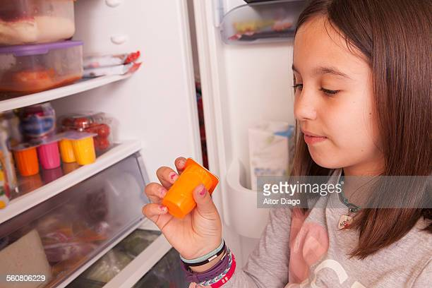 Girl looking into the fridge.