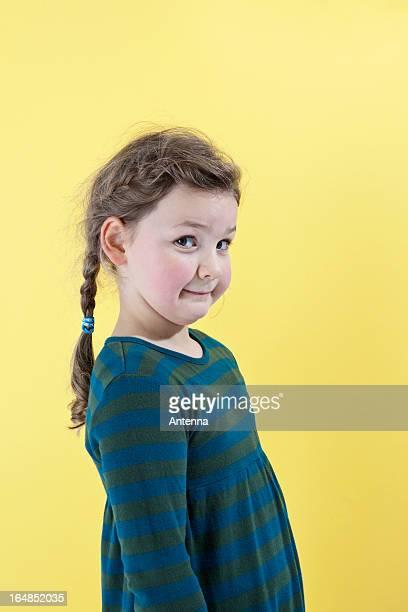 a girl looking mischievously into the camera - 8 9 jahre stock-fotos und bilder