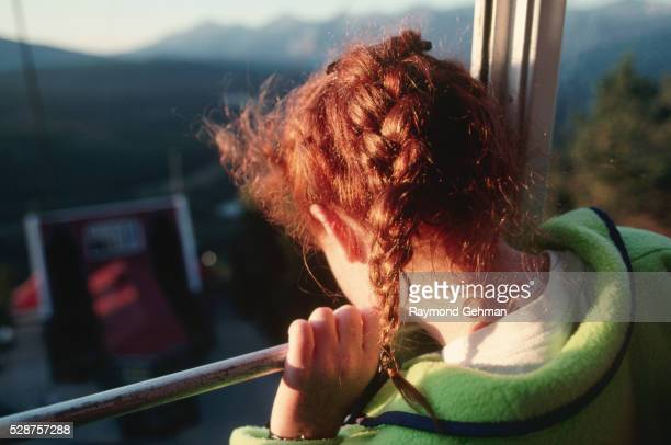Girl Looking out Aerial Tramway Window