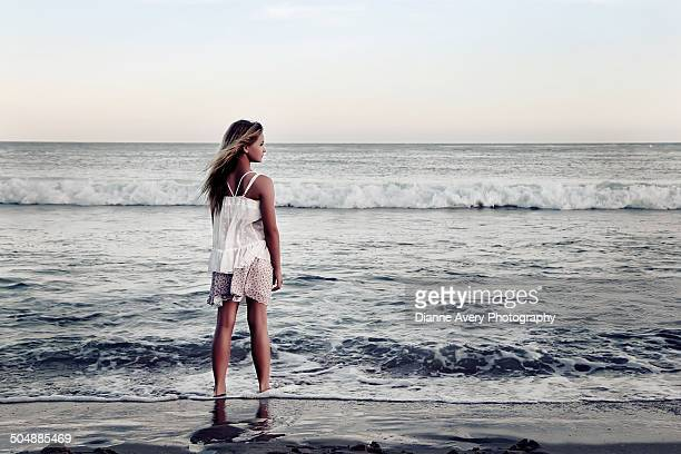Girl looking out at ocean