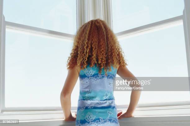 girl looking out corner windows - little girls bare bum stock pictures, royalty-free photos & images