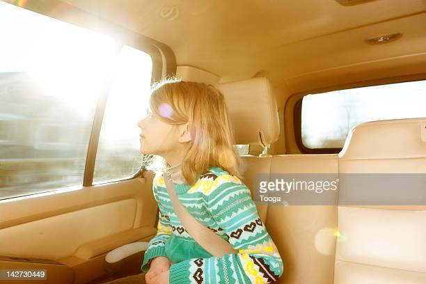 Girl looking out of car window