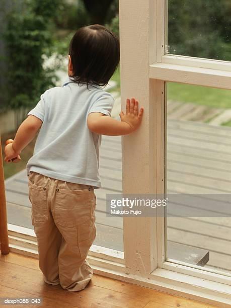 Girl looking out of door, waiting