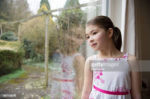 girl looking out of window - cobham surrey stock pictures, royalty-free photos & images
