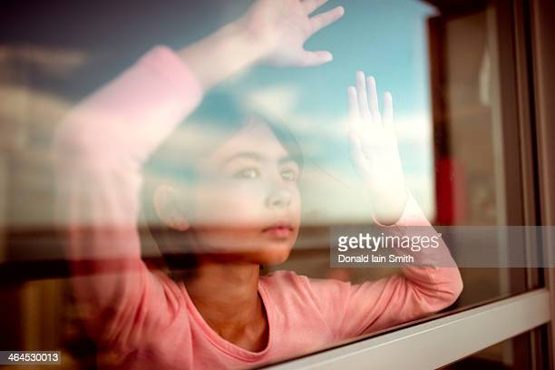 Girl looking out window.