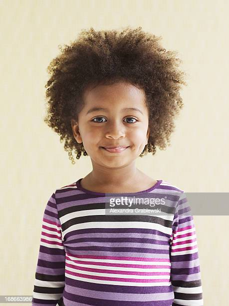 girl looking pleased - striped shirt stock pictures, royalty-free photos & images