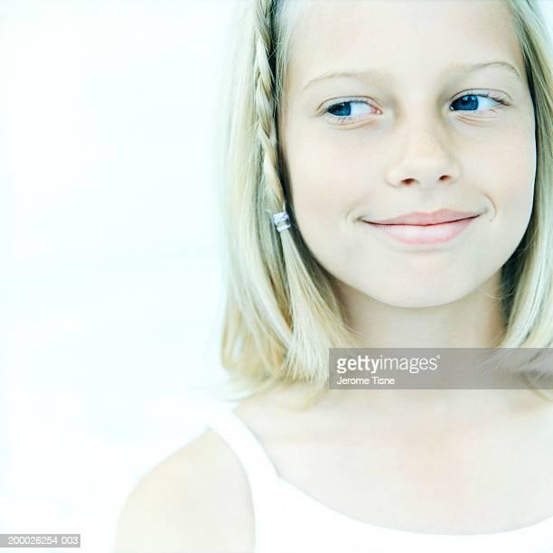 Girl (8-10) looking sideways, close-up