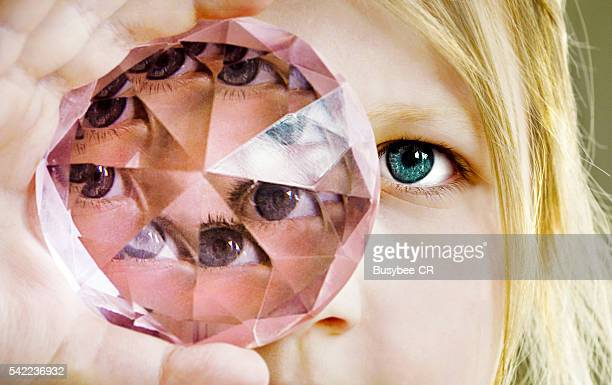 Girl looking through a prism glass