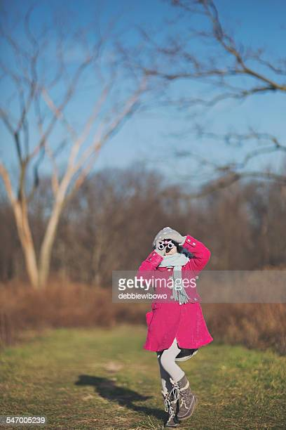 Girl (8-9) looking through binoculars
