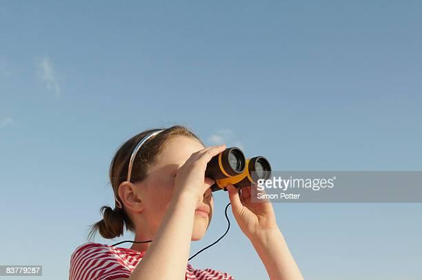 girl looking through binoculars - binoculars stock pictures, royalty-free photos & images