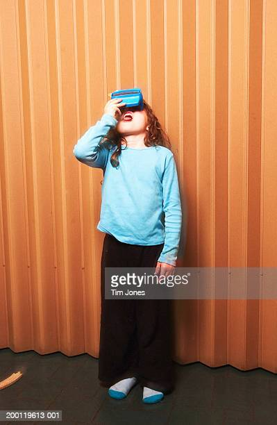 Girl (6-8) looking through picture viewer