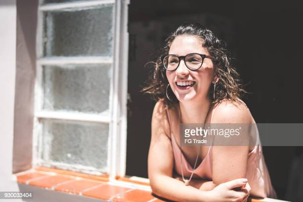 girl looking through the window - brazilian culture stock pictures, royalty-free photos & images