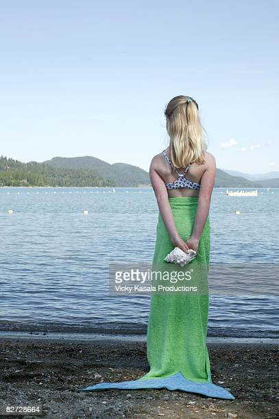 girl looking towards water - mid length hair stock pictures, royalty-free photos & images
