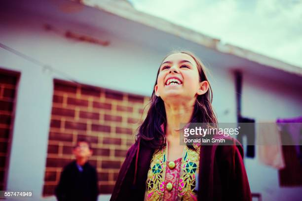 girl looking up and laughing - pakistan girl stock photos and pictures