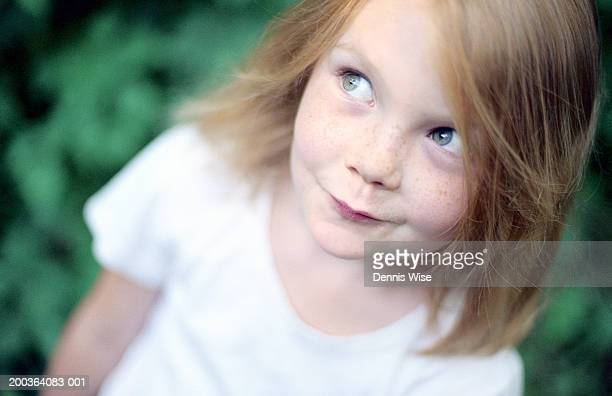 girl (6-8) looking up, elevated view - green eyes stock pictures, royalty-free photos & images
