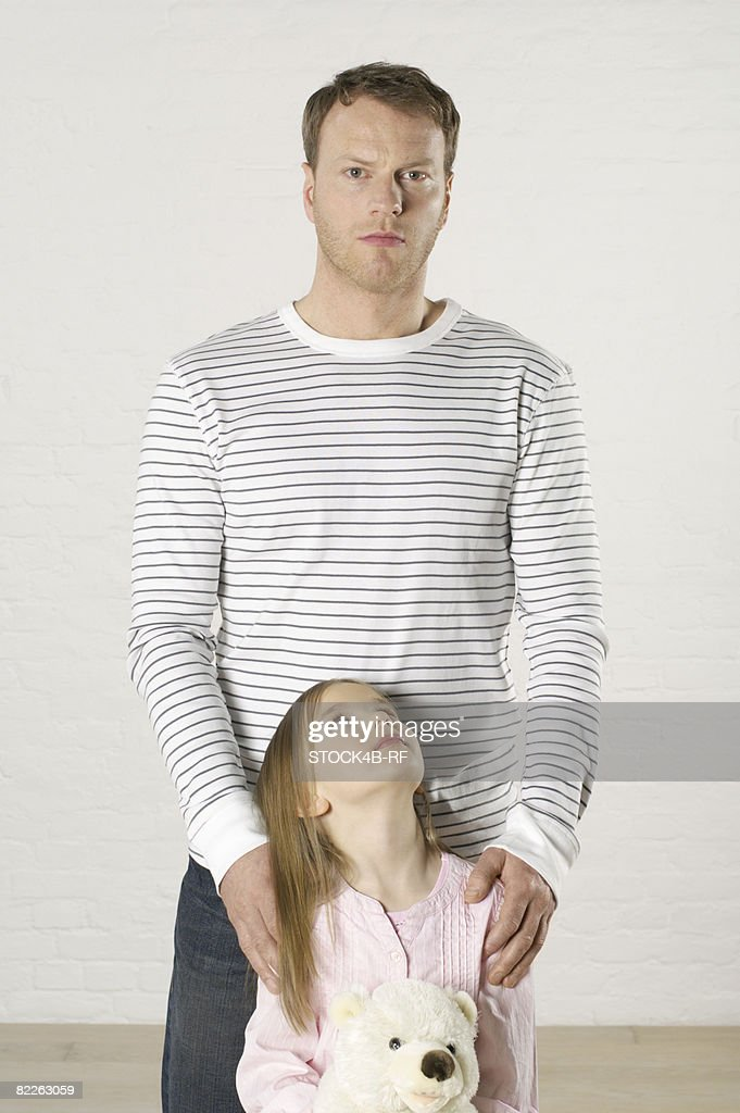 Girl looking up to father : Stock Photo