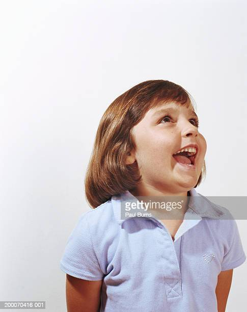 girl (4-6) looking upward, smiling - girls open mouth stock photos and pictures