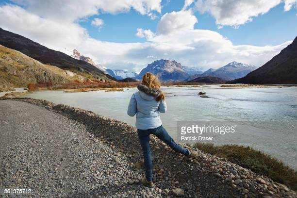 Girl looks at Andes mountains in Patagonia